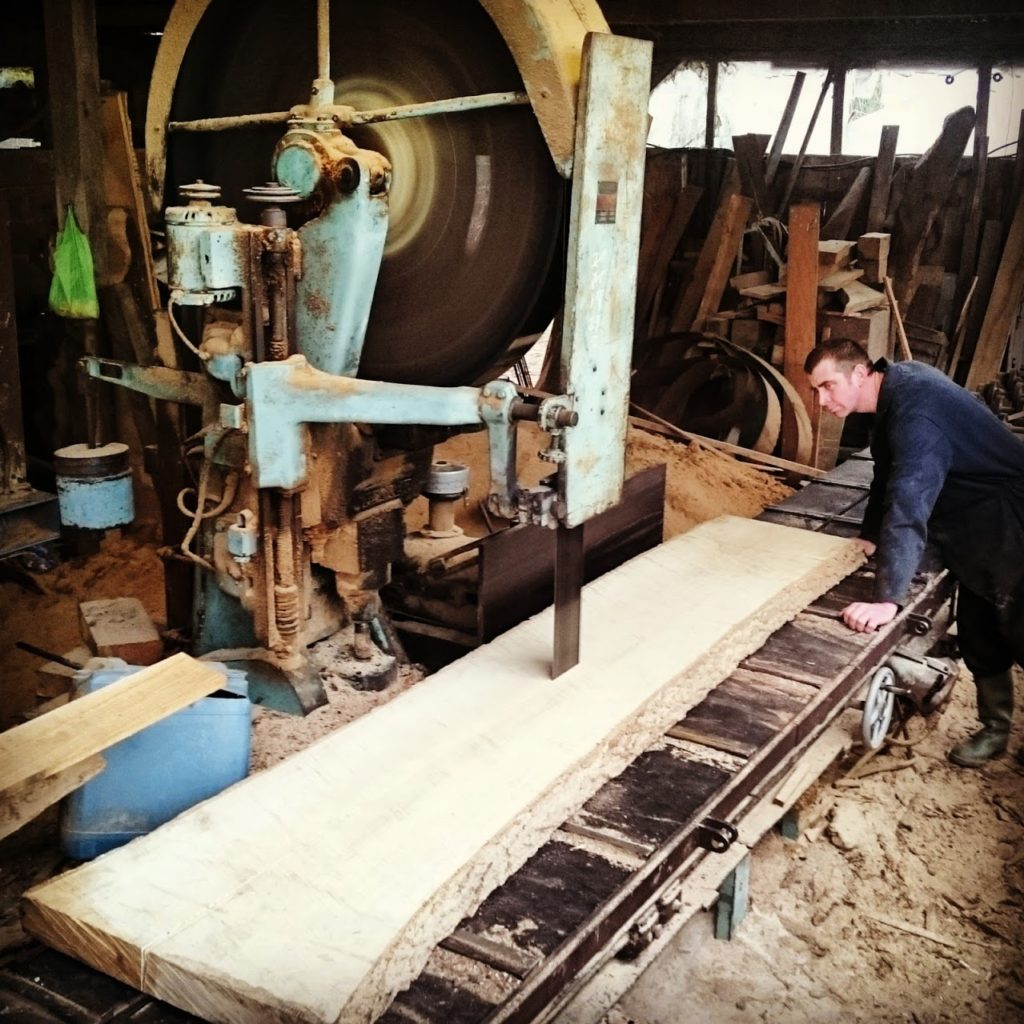 cutting the Ash panel at the saw mill