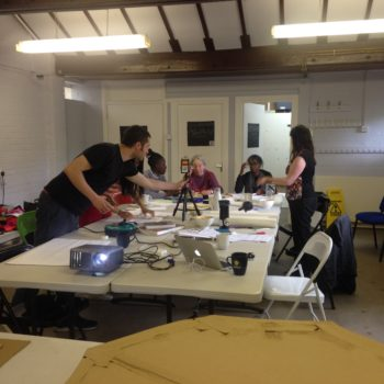 workshop participants working around a table in Furtherfield Commons