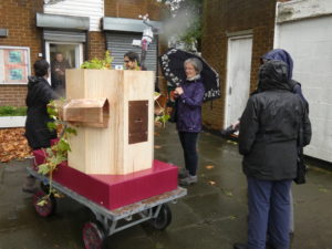 Future Machine decorated with hops and people who attended the launch in the rain