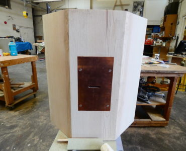 the ocatgon and copper front in Ian's carpentry workshop