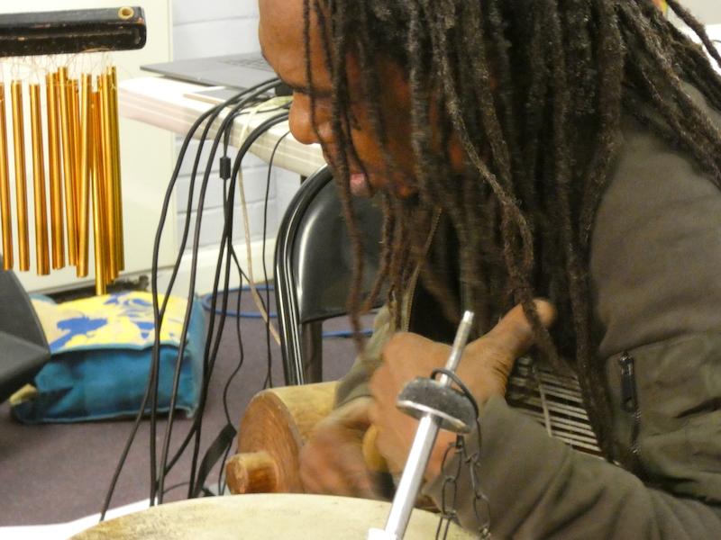 Alex playing a djembe