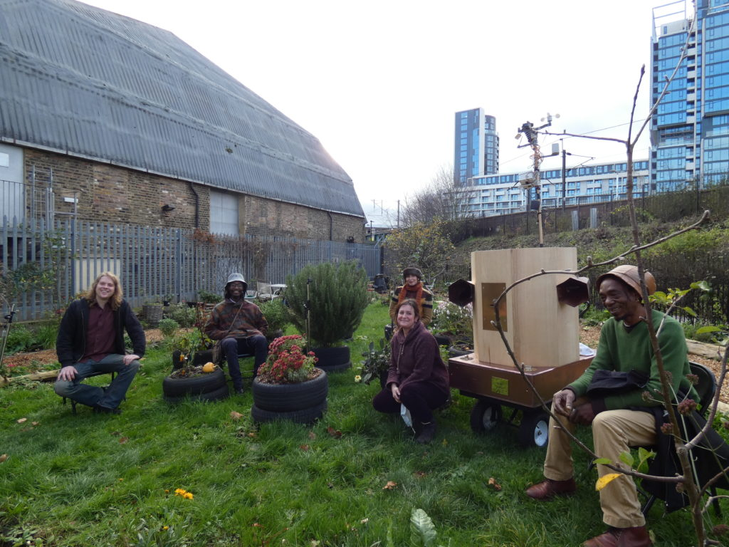 sitting in the drumming school garden from left to right David Kemp, Miles Ncube, Indira Lemouchi, Rachel Jacobs, the Future Machine, Alex Dayo